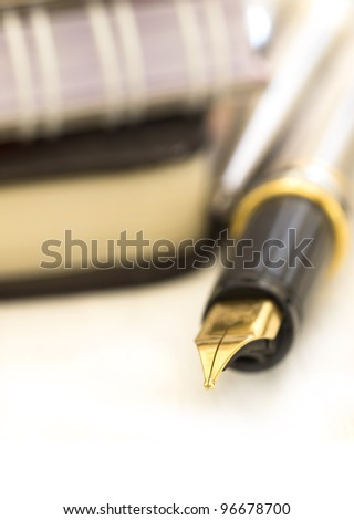 golden pen, shallow focus - stock photo