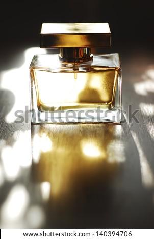 Golden Perfume Golden perfume bottle on a natural background