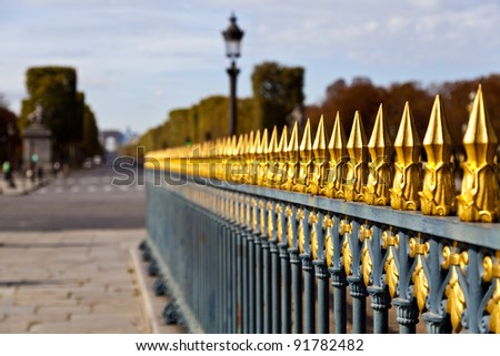 Golden picket fence around the Luxor obelisk at Place de la Concorde in Paris