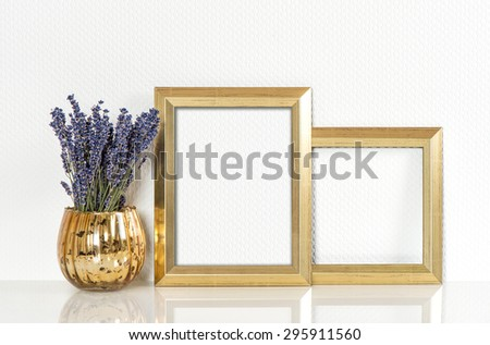 Golden picture frame and lavender flowers. Vintage style mock up for your photos and arts