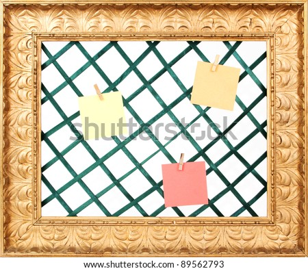 Golden picture frame with green holders and notes and a white background