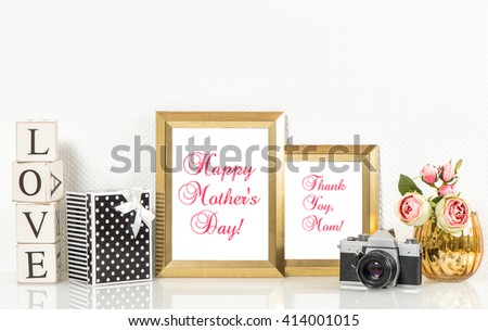 Golden picture frames, roses flowers and no name vintage camera. Copy space for Your designs. Happy Mothers Day! Mothers Day greetings card. Mothers Day concept. Mother\'s Day. Mothers Day gift