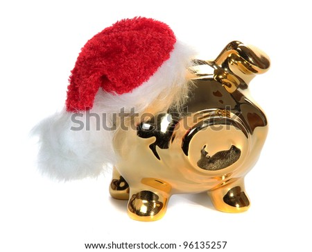 golden piggy bank with red jelly bag cap