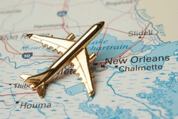 Golden plane over Louisana. Map is copyright free off goverment website.