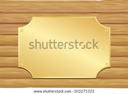 Golden plate on wooden background.