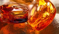 Golden polished pieses of amber macro photo close up