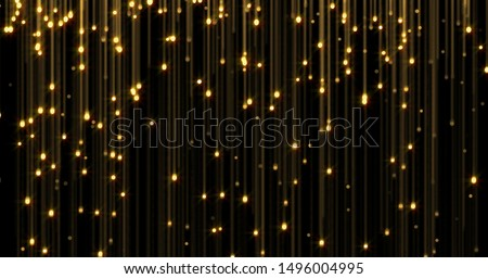 Golden rain, gold glitter particles falling. Glowing glittering lights on golden threads, shiny sparkling light and shimmer particles