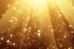 Golden rays and sparkles or glitter lights. Merry Christmas festive background.defocused circle bokeh or particles