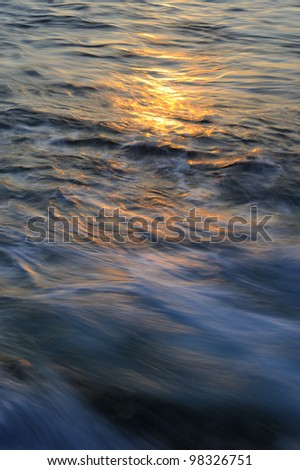 Golden reflections on the ocean surface.