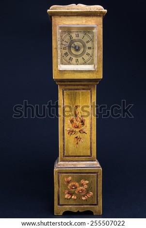 golden retro alarm clock tower shaped, antique mechanical watch #255507022