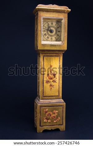 golden retro alarm clock tower shaped, antique mechanical watch #257426746