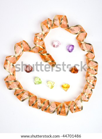 Golden ribbon as heart. Isolated. Jewerly also