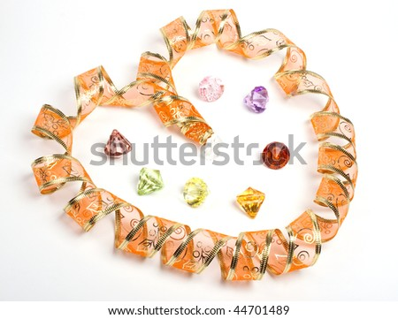 Golden ribbon as heart. Isolated. Jewerly also - stock photo
