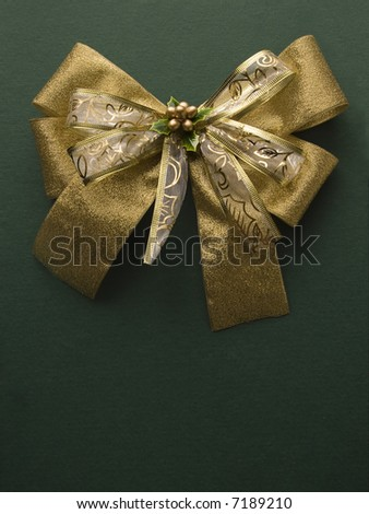 golden ribbon on top of christmas present