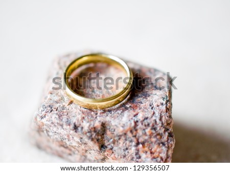 Golden ring on stone