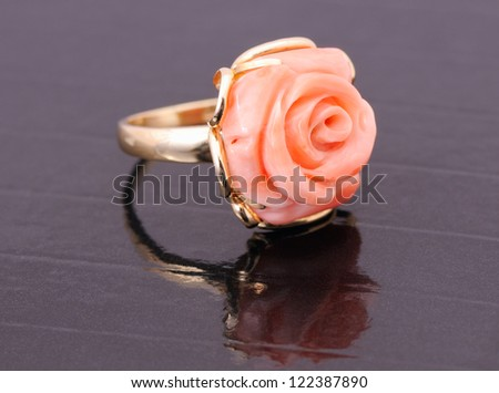 golden ring with coral gem, closeup