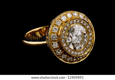 Golden ring with diamonds on black background