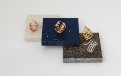 Golden rings set on natural granite stone