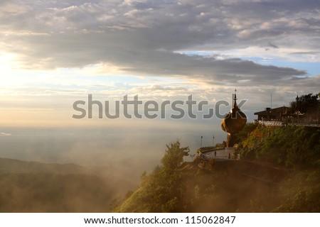 Golden rock fog in the evening light, Kyaiktiyo Pagoda in Yangon, Myanmar
