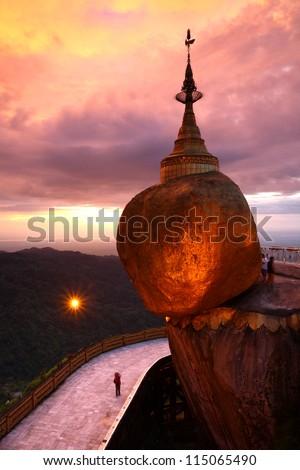 Golden rock is beautiful in the sunrise , Kyaiktiyo Pagoda in Yangon, Myanmar