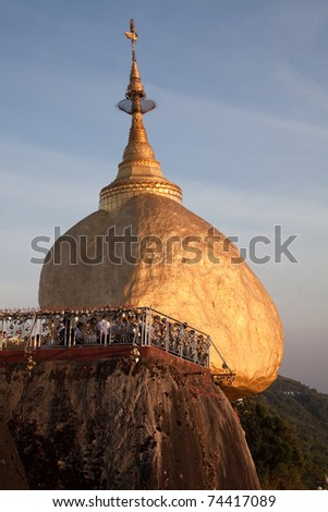 Golden Rock with praying people - one of the most Buddhist worship place in Burma.