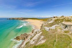 golden sand beach at the rocky coastline of Brittany, near Camaret-sur Mer, France