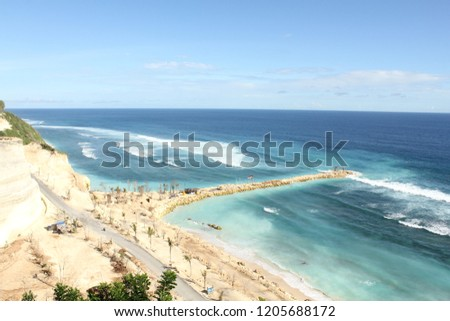golden sand beach with blue sea #1205688172