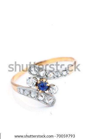 golden sapphire ring with diamonds isolated against a white background