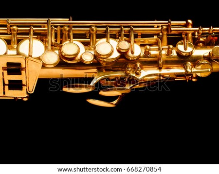 Golden saxophone isolated on black background. Studio high-resolution image. #668270854