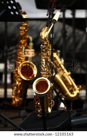 golden saxophones on stage