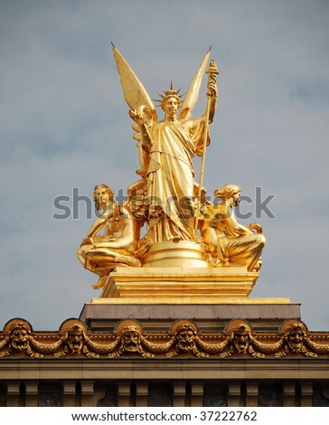 Golden sculptural group of a female angel holding a harp on the roof of the Opera Garnier, Paris, France.
