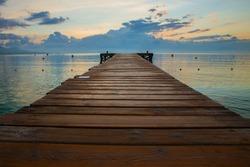 Golden sea sunset on the wooden pier. Spain, Mallorca.