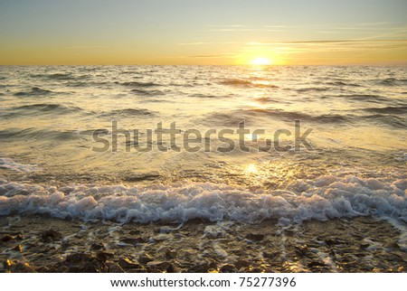 Golden sea sunset with braking waves