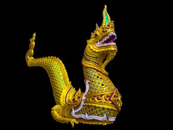 Golden serpent king or king of naga statue isolated on black background - clipping paths. Sculpture of serpent. An ancient temple Lanna style architecture.
