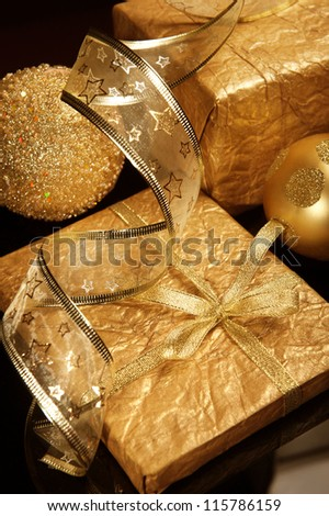 Golden set of Christmas decorations over deep dark background