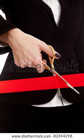 Golden shears cut a long, big, red ribbon