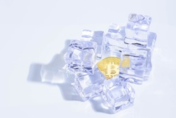 Golden Shining Bitcoin the Top of Cryptocurrency under the Ice Rock