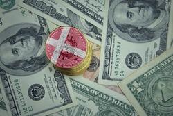 golden shining bitcoins with flag of denmark on a dollar money background. bitcoin mining concept.