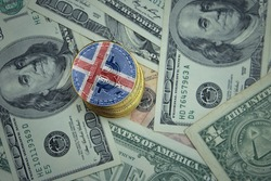 golden shining bitcoins with flag of iceland on a dollar money background. bitcoin mining concept.