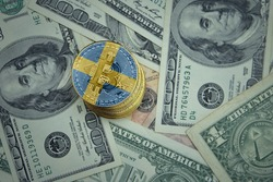 golden shining bitcoins with flag of sweden on a dollar money background. bitcoin mining concept.