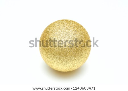 Golden shiny christmas ball isolated on a white background. Decorative toy.