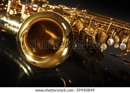 golden shiny saxophone on black background