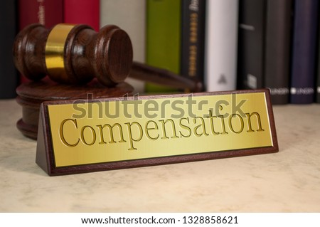 Golden sign with gavel and compensation