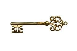 Golden skeleton key isolated on white background