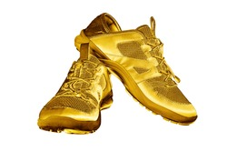 Golden sneakers white background isolated closeup, gold metal sport shoes, luxury running gumshoes, fashion yellow metallic fitness boots, athletic, football footwear, winner, victory, champion symbol