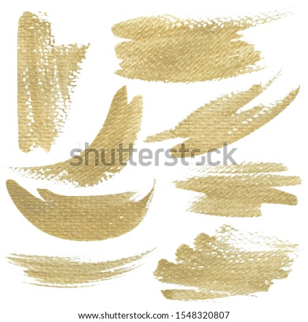Golden splotches isolated on white background, brush strokes with real gold texture