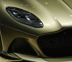 Golden sports car headlight and spoiler