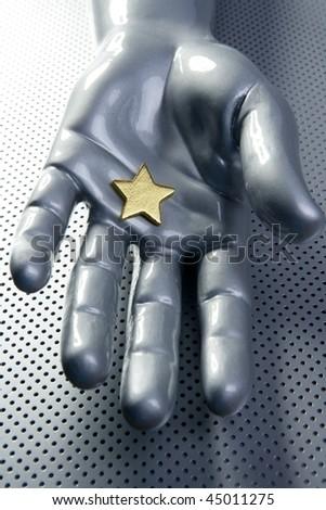 Golden star on silver futuristic hand christmas concept metaphor
