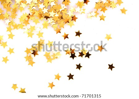 Golden stars in the form of confetti on white
