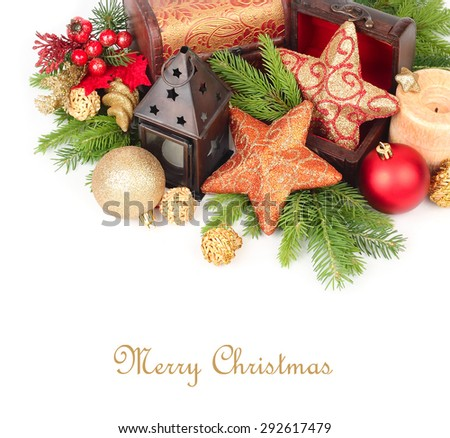 Golden stars in wooden chests, candles and other Christmas-tree decorations on branches of a Christmas tree on a white background. A Christmas background with a place for the text.